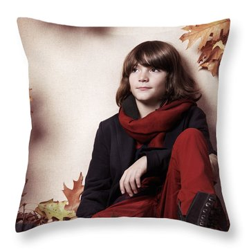 Boy Sitting On Autumn Leaves Artistic Portrait Throw Pillow by Oleksiy Maksymenko