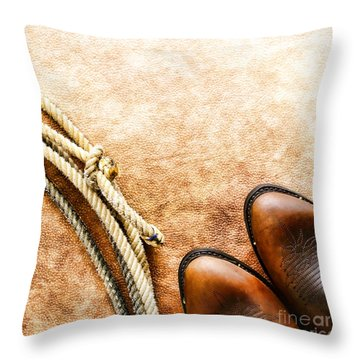 Cowboy Boots And Lasso Throw Pillow by Olivier Le Queinec