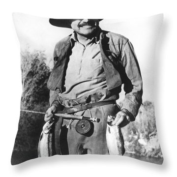 Ernest Hemingway Fishing Throw Pillow by Underwood Archives