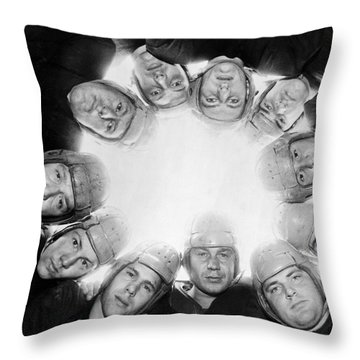 Football Team Huddle Throw Pillow by Underwood Archives