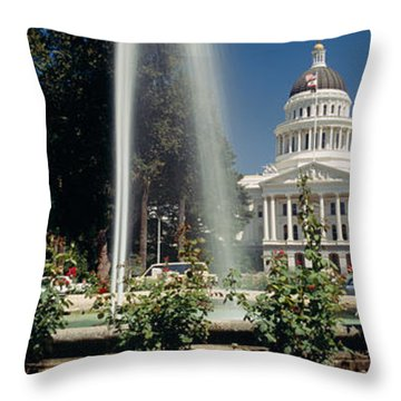 Fountain In A Garden In Front Throw Pillow by Panoramic Images