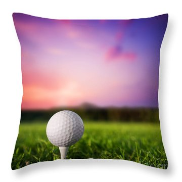 Golf Ball On Tee At Sunset Throw Pillow by Michal Bednarek
