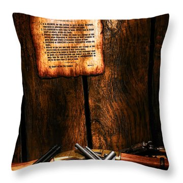 Gun Control Throw Pillow by Olivier Le Queinec