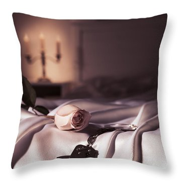 Handcuffs And A Rose On Bed Throw Pillow by Oleksiy Maksymenko