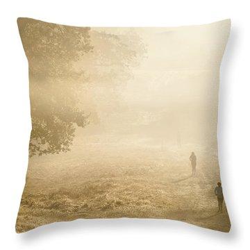 Joggers In Richmond Park London On A Crisp Foggy Autumn Morning Throw Pillow by Matthew Gibson