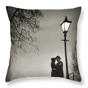Lovers Say Goodbye Under A Streetlamp Throw Pillow by Lee Avison