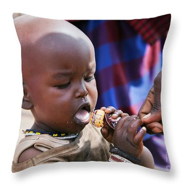 Maasai Child Trying To Eat A Lollipop In Tanzania Throw Pillow by Michal Bednarek