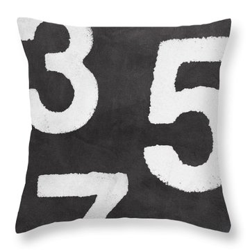 Odd Numbers Throw Pillow by Linda Woods