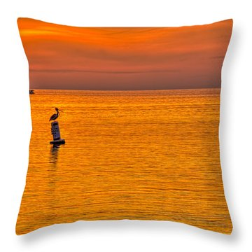 Pelican On A Buoy Throw Pillow by Marvin Spates