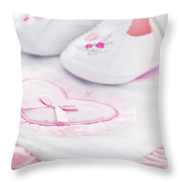 Pink Baby Girl Clothes Throw Pillow by Elena Elisseeva