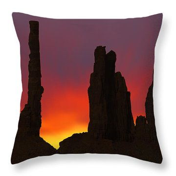 Silhouette Of Totem Pole After Sunset - Monument Valley Throw Pillow by Mike McGlothlen