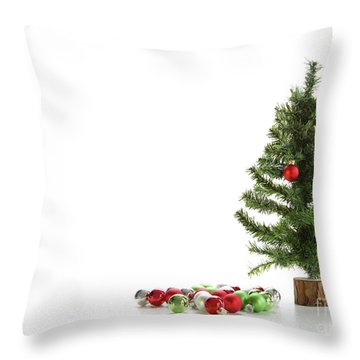 Small Artifical Tree With Ornaments On White Throw Pillow by Sandra Cunningham