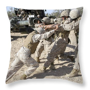 Soldiers Move The Muzzle-end Of A M777 Throw Pillow by Stocktrek Images