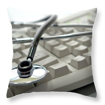 Stethoscope On Computer Keyboard Throw Pillow by Olivier Le Queinec