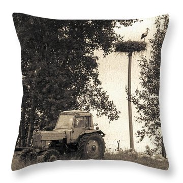 Stork Vs Tractor Throw Pillow by Yevgeni Kacnelson
