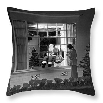 This Beverly Hills Resident Is Putting The Finishing Touches On Throw Pillow by Underwood Archives