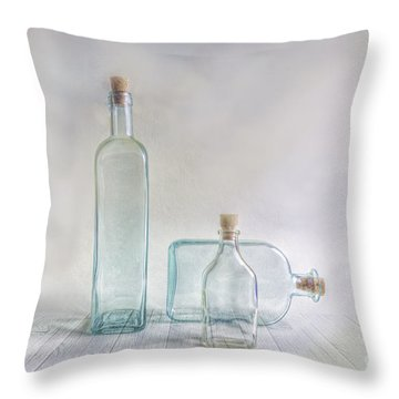 Three Bottles Throw Pillow by Veikko Suikkanen