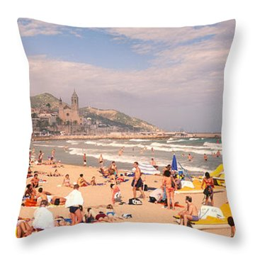 Tourists On The Beach, Sitges, Spain Throw Pillow by Panoramic Images