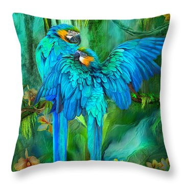 Tropic Spirits - Gold And Blue Macaws Throw Pillow by Carol Cavalaris
