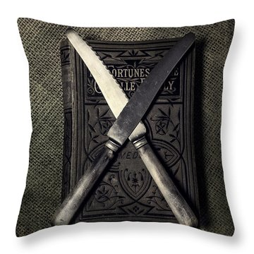 Two Knives And A Book Throw Pillow by Joana Kruse