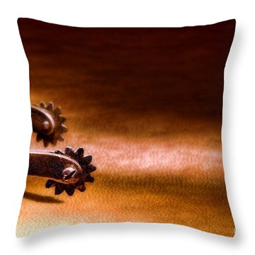 Western Spurs Throw Pillow by Olivier Le Queinec