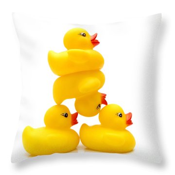 Yelow Ducks Throw Pillow by Bernard Jaubert