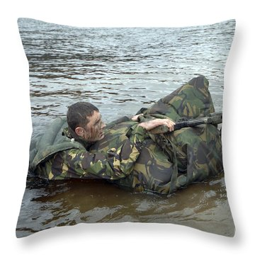A Soldier Participates In A River Throw Pillow by Andrew Chittock