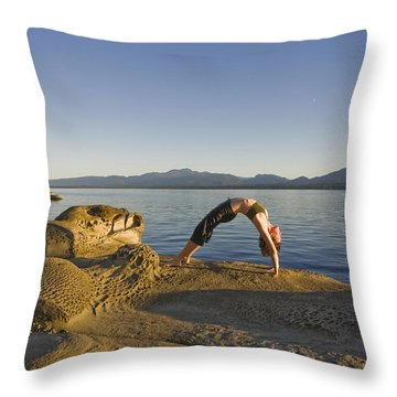 A Woman Does Yoga At Sunset Throw Pillow by Taylor S. Kennedy