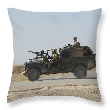 British Soldiers Patrol Afghanistan Throw Pillow by Andrew Chittock
