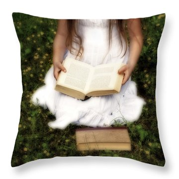 Girl Is Reading A Book Throw Pillow by Joana Kruse