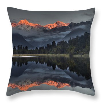 Sunset Reflection Of Lake Matheson Throw Pillow by Colin Monteath
