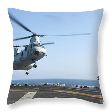 A Ch-46e Sea Knight Helicopter Prepares Throw Pillow by Stocktrek Images