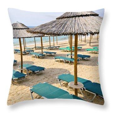 Beach Umbrellas On Sandy Seashore Throw Pillow by Elena Elisseeva