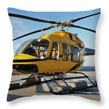 A Bell 407 Utility Helicopter Throw Pillow by Terry Moore