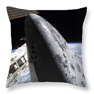 Space Shuttle Discovery Docked Throw Pillow by Stocktrek Images
