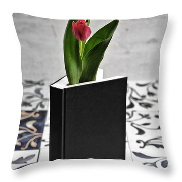 Tulip In A Book Throw Pillow by Joana Kruse