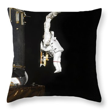Astronaut Working On The Hubble Space Throw Pillow by Stocktrek Images