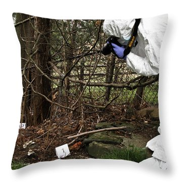 Criminal Investigation Throw Pillow by Photo Researchers, Inc.