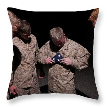 U.s. Marines Fold The American Flag Throw Pillow by Terry Moore