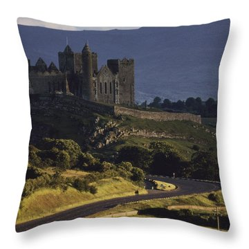 A Ancient Romanesque Castle Sits Atop Throw Pillow by Cotton Coulson