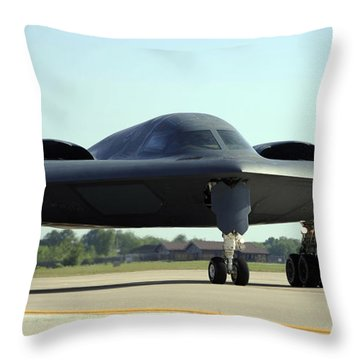 A B-2 Spirit Taxis Onto The Flightline Throw Pillow by Stocktrek Images
