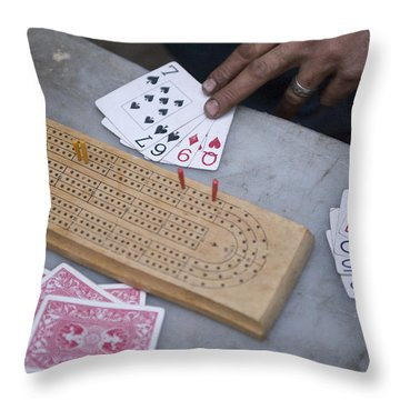 A Card Game Being Played In Kings Throw Pillow by Joel Sartore