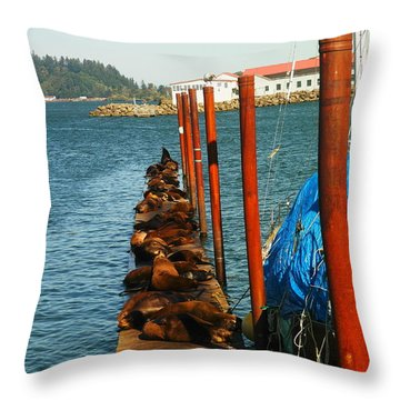 A Dock Of Sea Lions Throw Pillow by Jeff Swan
