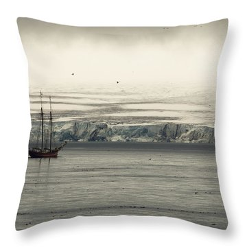 A Double-masted Sailboat Floats Near An Throw Pillow by Norbert Rosing