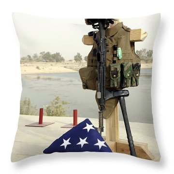 A Fallen Soldiers Gear Display Throw Pillow by Stocktrek Images