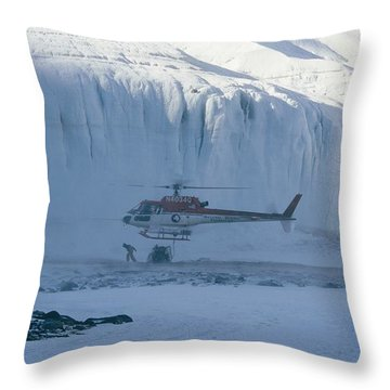 A Helicopter Delivers Supplies Throw Pillow by Maria Stenzel