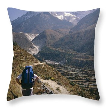 A Hiker With A Mountain Range Throw Pillow by Michael Klesius