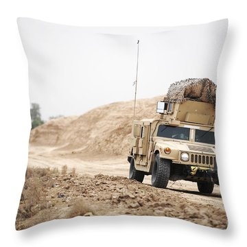 A Humvee Conducts Security Throw Pillow by Stocktrek Images