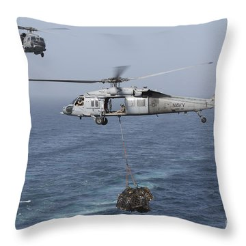 A Mh-60s Knighthawk Transfers Cargo Throw Pillow by Gert Kromhout