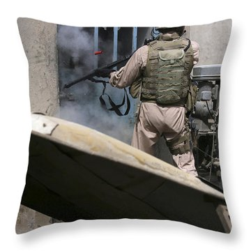 A Military Policeman Uses A Breaching Throw Pillow by Stocktrek Images
